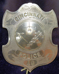 Badge typically worn in Patrolman Nuttle's era.