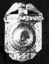 Patrolman Ernest E. Cole's badge