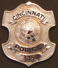 "Police Officer Clifford W. George""s badge"