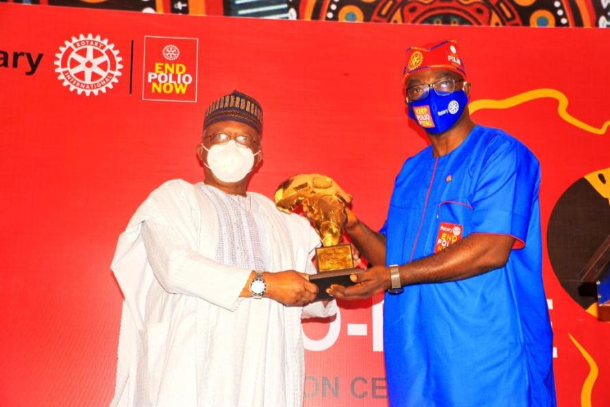 PRIVP Yinka Babalola presents award to His Excellency President Muhammadu Buhari, represented by Dr Osagie Ehanire, Hon. Minister of Health.