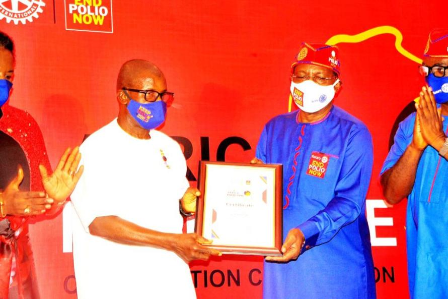 Presentation of Certificate to Sir Emeka Offor.