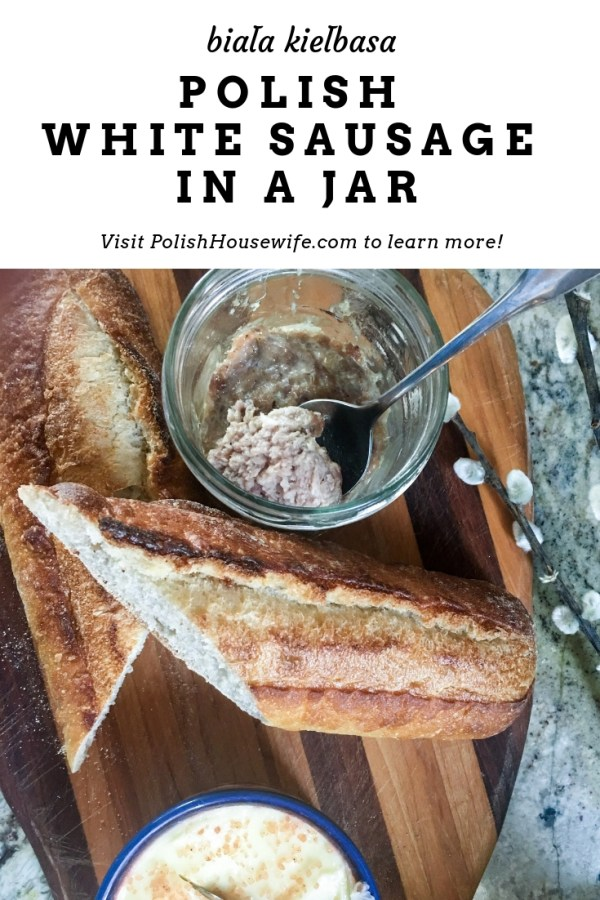 sausage in a jar, butter, and a baguette on a cutting board