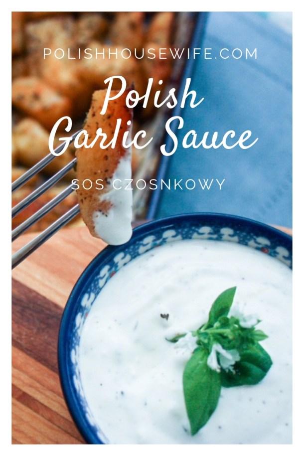 garlic sauce in polish pottery ramekin on cutting board with roasted potatoes
