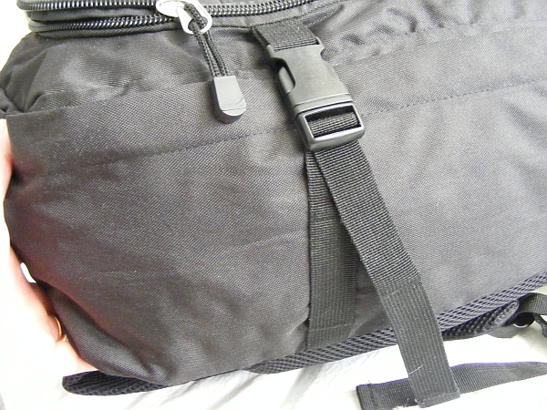 image of the military style pull tight straps to compress the cabin max backpack