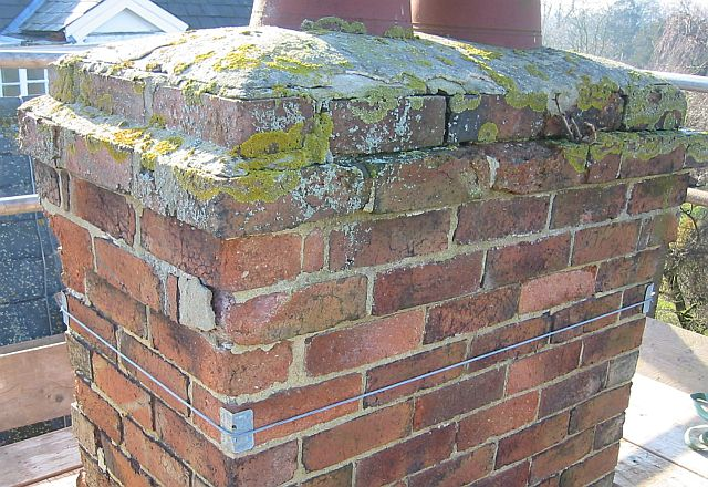 old crumbling chimney brickwork