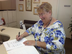 Photo: Declaration signing Marilyn Lubarsky, Co-chair