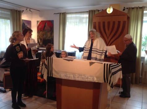Rabbi Brener adding to the Hakafot