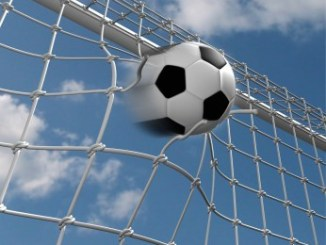 Soccer ball over blue sky