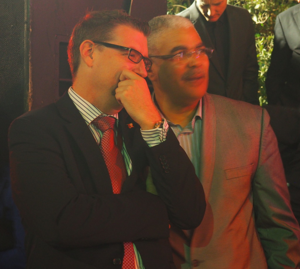 Michael Fahy and Craig Cannonier share a private moment at celebration welcoming the America's Cup