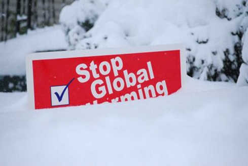 stop-global-warming-sign-buried-in-snow