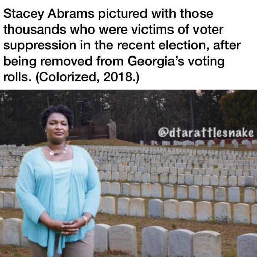stacy abrams with picture voter suppression graveyard