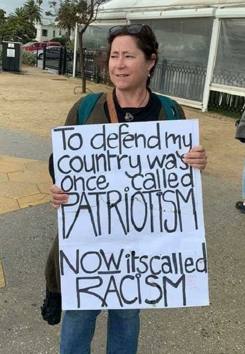sign defend my country used to be called patriotism now its called racism