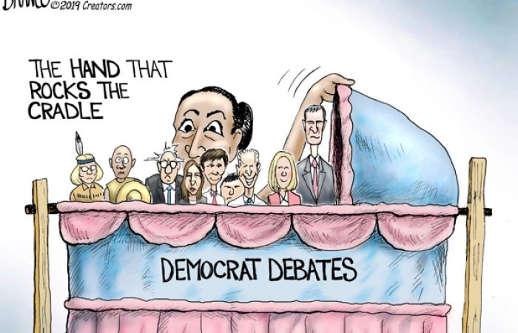 aoc ocasio cortez hand that rocks cradle democratic debates warren bernie booker orourke