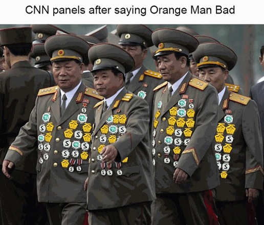 cnn panel after saying orange man bad pinning medals on jackets