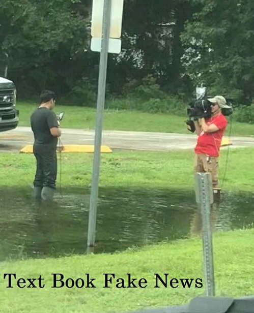 text book fake news reporters in large puddle