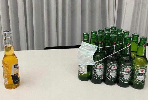 corona bottle separated by heinken in mask