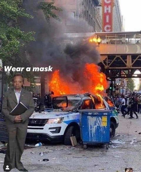lori lightfoot mayor chicaco burning protesters put on mask