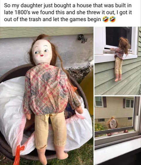 daughter bought 1800s house doll hanging from window