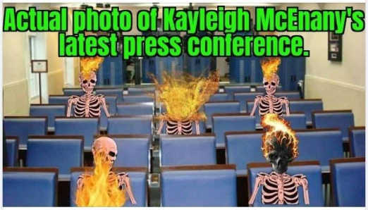 actual photo kayleigh mcenany latest press conference skeletons on fire exploding