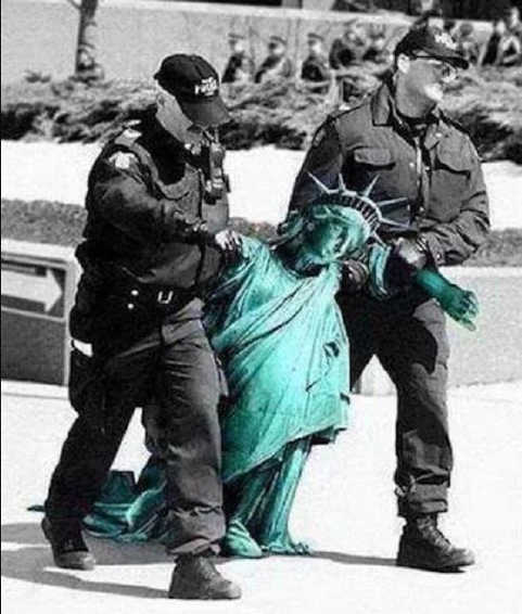 usa soldiers dragging arresting statue of liberty
