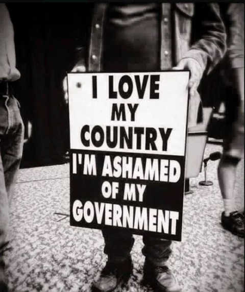 message love my country im ashamed of my government sign