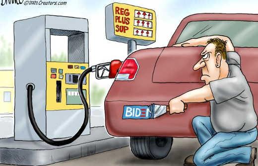 biden gas prices up guy scraping bumper sticker