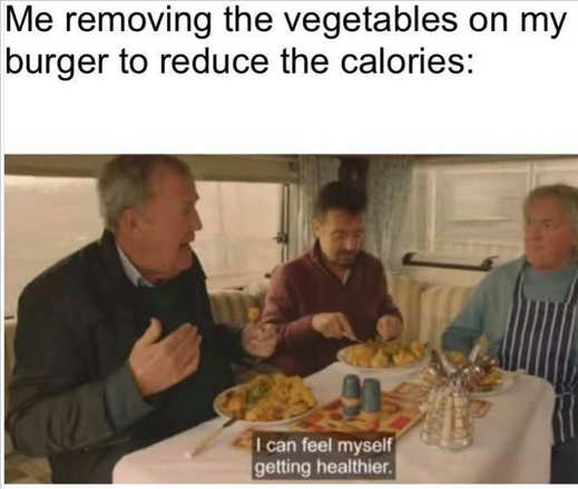 me removing vegetables on burger to reduce calories
