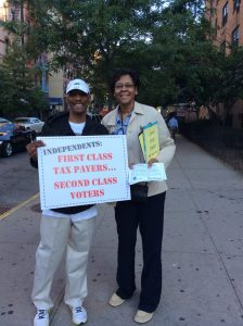 Allen Cox with Dr. Jessie Fields in Harlem on Primary Day.
