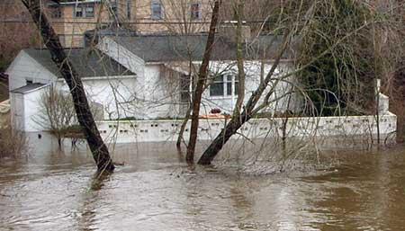 Nor'eastern flooding. flooded home. Farmington River, Simsbury CT