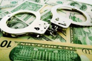 corruption handcuffs