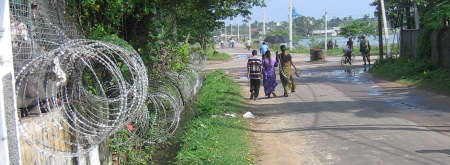 D.J. Mitchell photo: Razor wire intrudes on this street scene in Batticaloa.