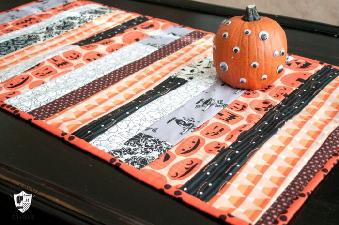 "Cute ""quilt as you go"" Halloween table runner tutorial on polkadotchair.com 13 Spooky Halloween Sewing Projects"