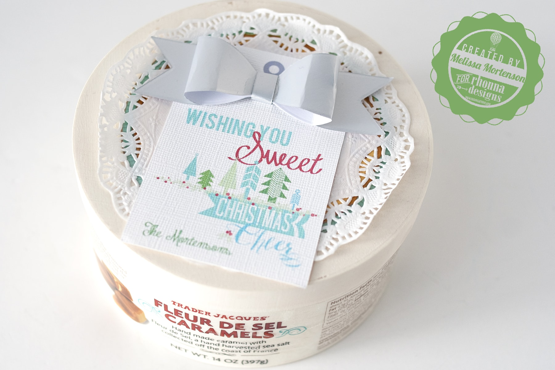 Cute idea for tags for neighbor treats for Christmas. Layer the tag on a doily with a paper bow, could even use with store bought treats