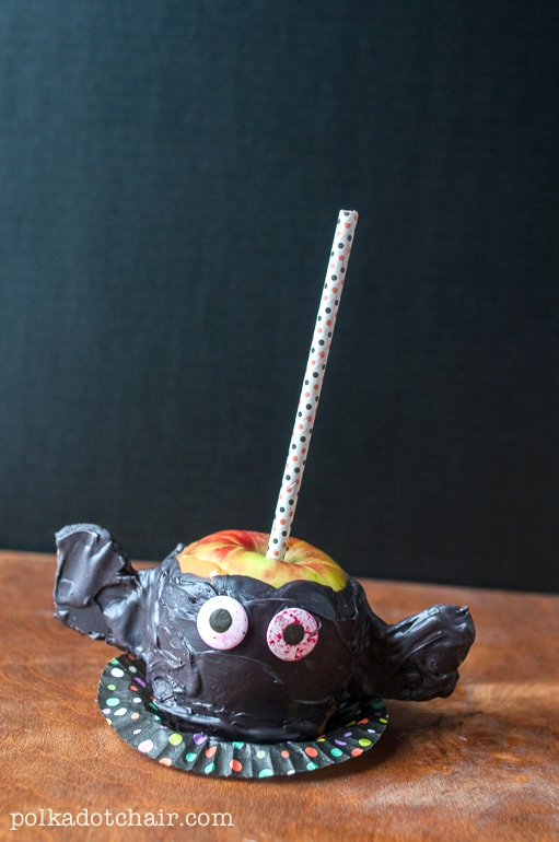 Recipe for Caramel Apples decorated like monsters, so cute! Great idea Halloween food to serve.