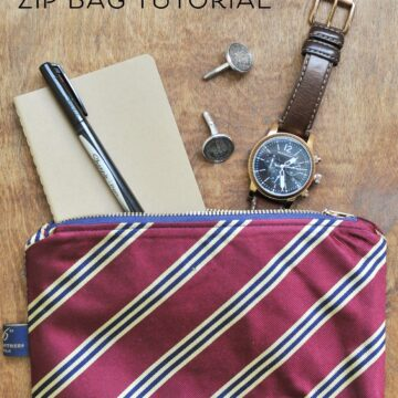 Upcycled neck tie zip pouch on brown table