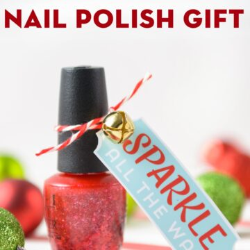 Nail Polish Gift on white table with Christmas ornaments