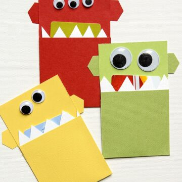 DIY Monster Gift Card Holder, a cute way to give a gift card to a kid for Christmas. Make it yourself at home with only paper.