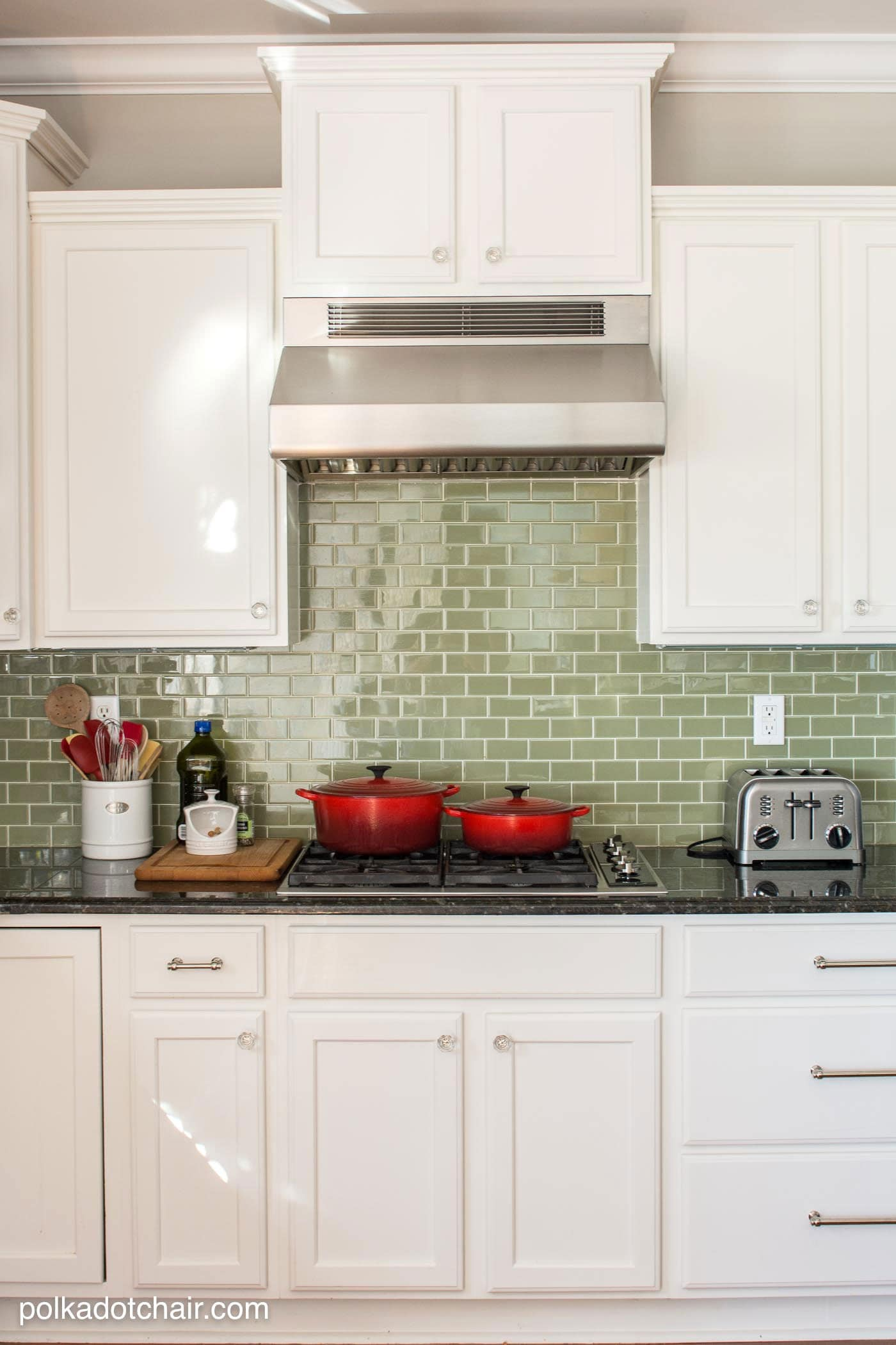Green Glass Tile Backsplash & Before and After Photos of a Kitchen that had it's Cabinets Painted White- lots of great ideas for decorating a farmhouse style kitchen!