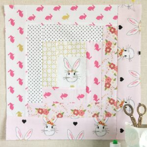 Free Quilt Tutorial and Pattern for a Log Cabin Quilt block; the April Block of the Month offered on the Polka Dot Chair Blog
