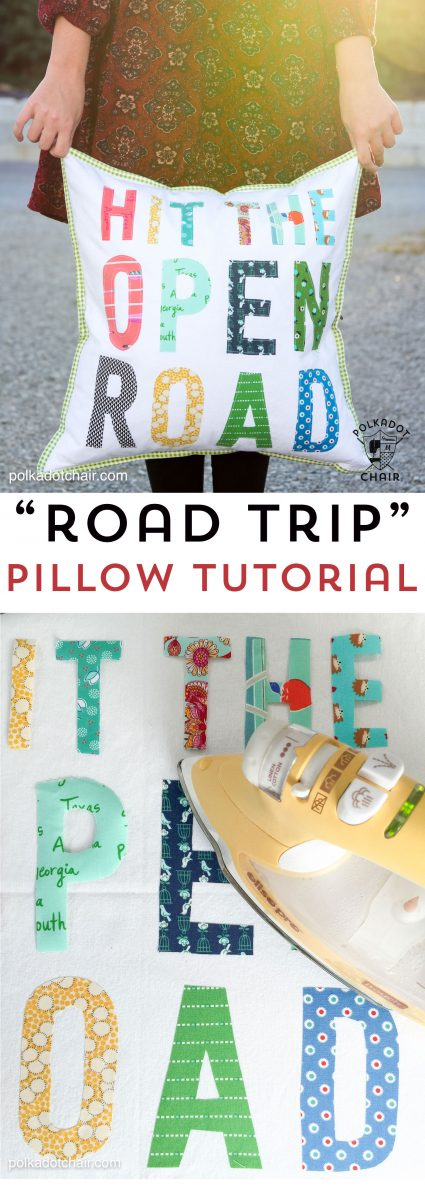 Hit the Open road pillow being held in front of an RV