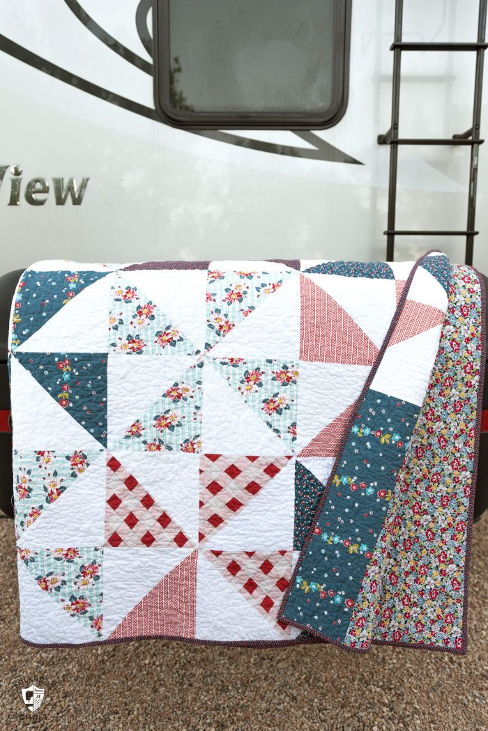 "Summertime Pinwheel Quilt - so easy you can make it with a bunch of layer cakes or 10"" stackers. A simple summer quilt to make"