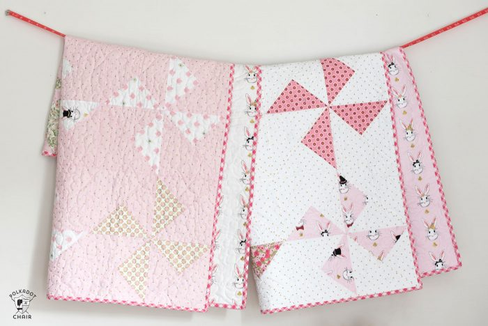 Free baby quilt patterns including this one for a simple baby quilt made using a Turnstile Quilt block! So easy you could make it in a day.