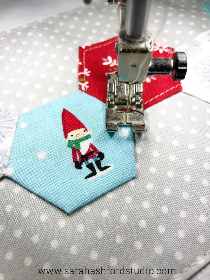 Super cute Christmas Hexie Tea Towel tutorial by Sarah Ashford. Such a fun Christmas gift idea ; learn how to sew hexagons! #christmasgifts #christmassewing #hexies #hexagons #hexagontutorial #christmasfabric #teatowel