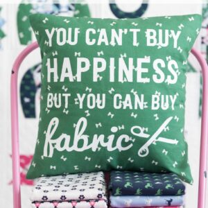"A DIY Pillow cover that is a great way to spruce up your sewing room decor. Includes a free cricut cut file for the ""fabric happiness"" saying."