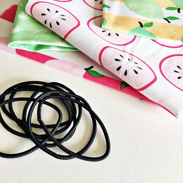 fabric and black elastics on table