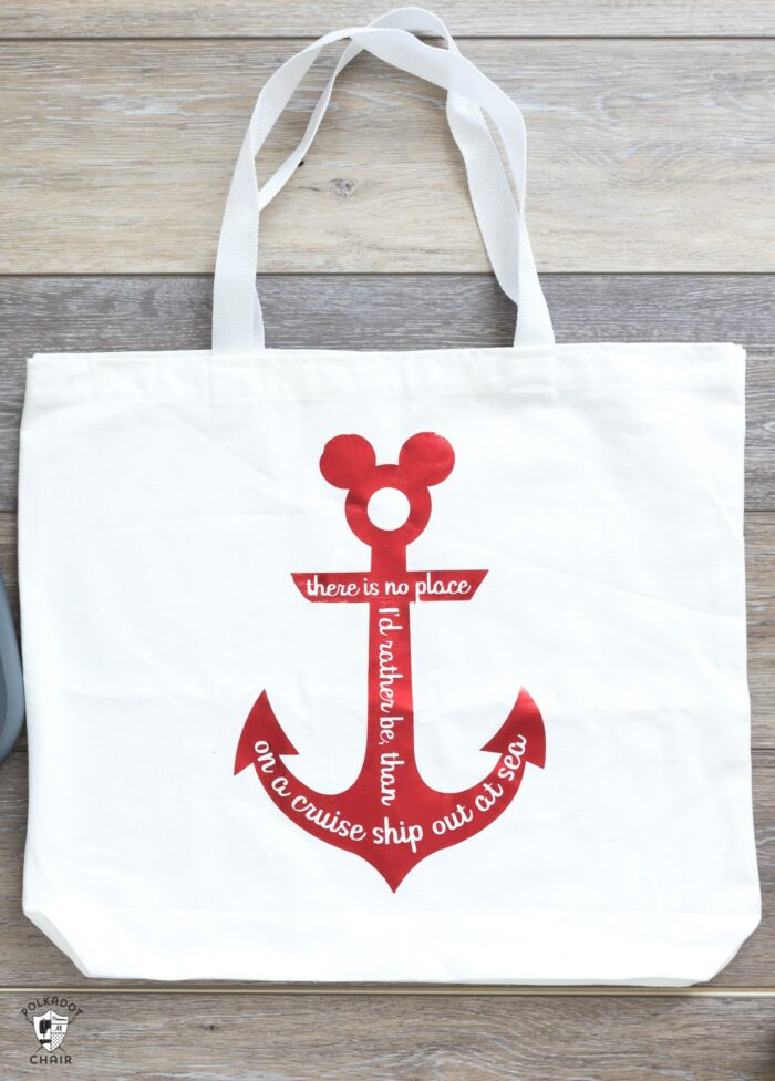 White tote bag with red Disney Cruise anchor and text