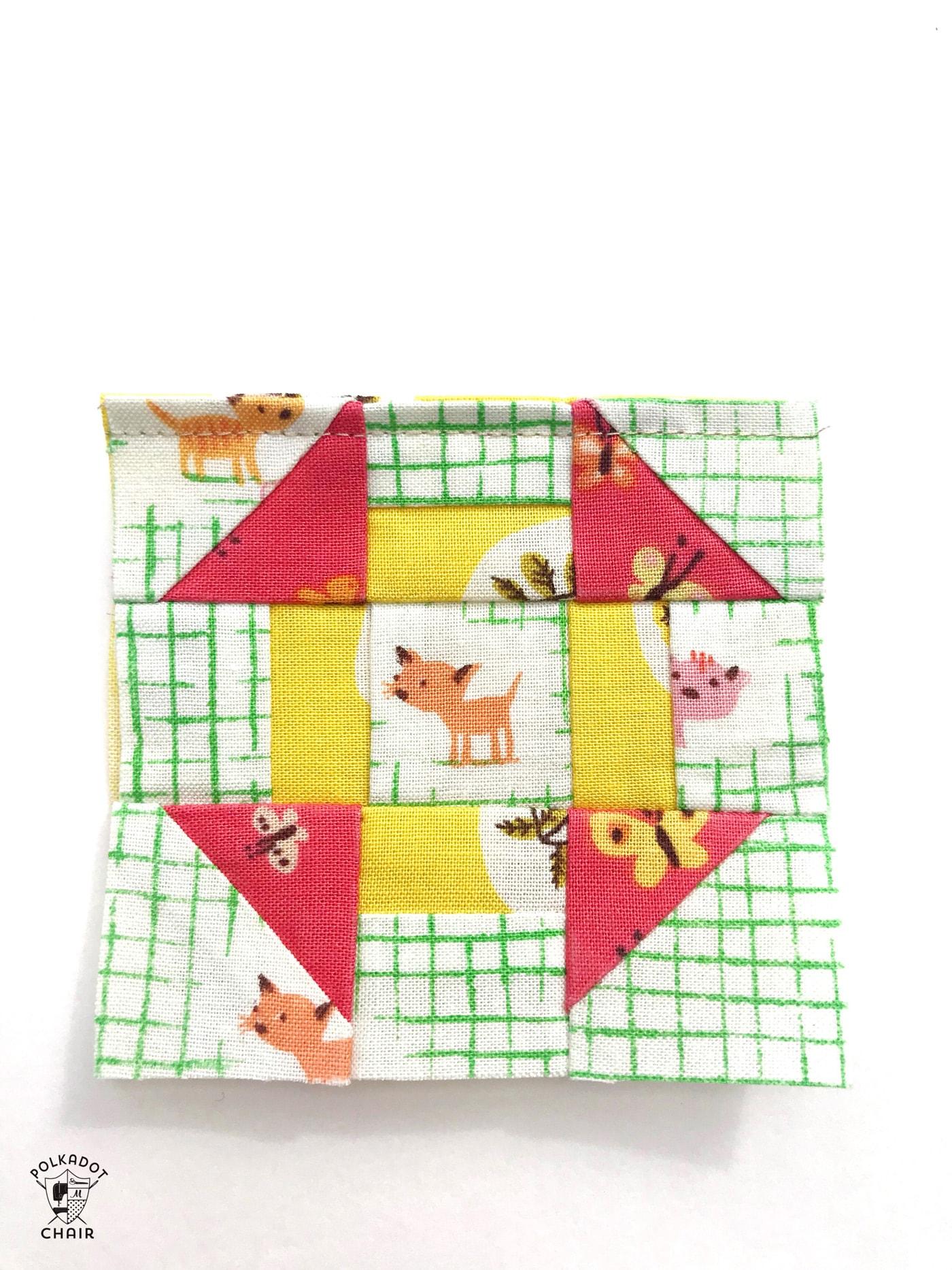 mini churn dash quilt block for pincushion