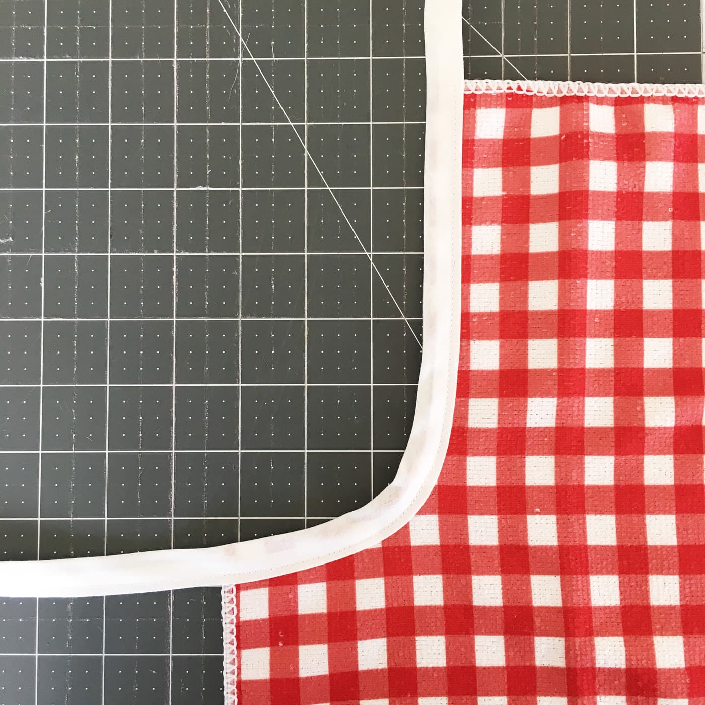 Attaching bias tape to the edge of the kids apron