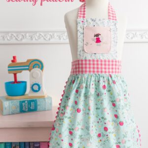 child's apron on dress form