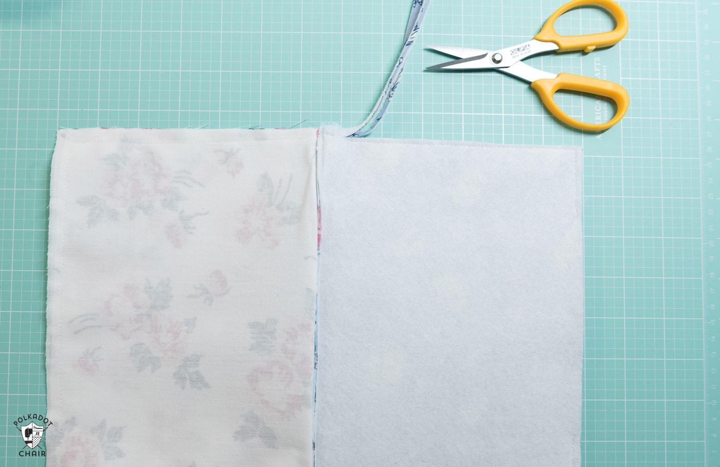 scissors zippered pouch tutorial in progress on cutting mat